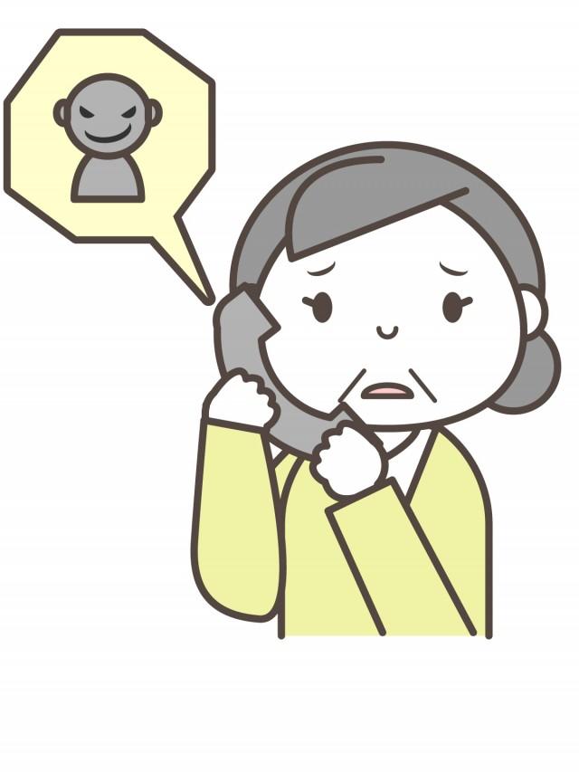 無料イラスト素材:不審な電話を受ける女性